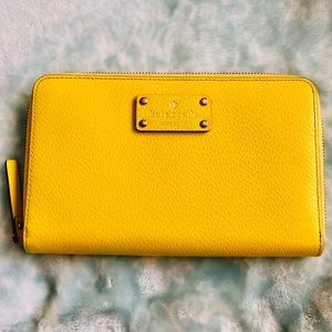 Kate Spade Travel Size Wallet in Taxi Yellow